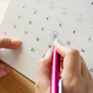 person circles date on calendar for eye doctor appointment