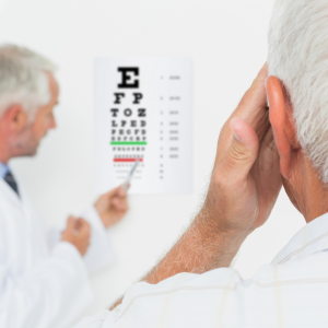 doctor gives patient eye exam to decide if he needs new glasses